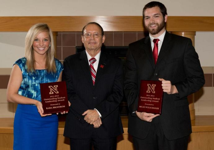 Outstanding Student Leader Award recipients from 2011-2012 Kara Brostrom and Micah Wullschleger with Juan Franco, vice chancellor for student affairs.