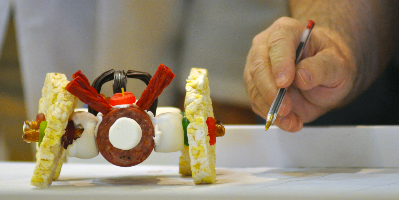 A judge examines an entry from the 2011 Incredible, Edible Car Competition.