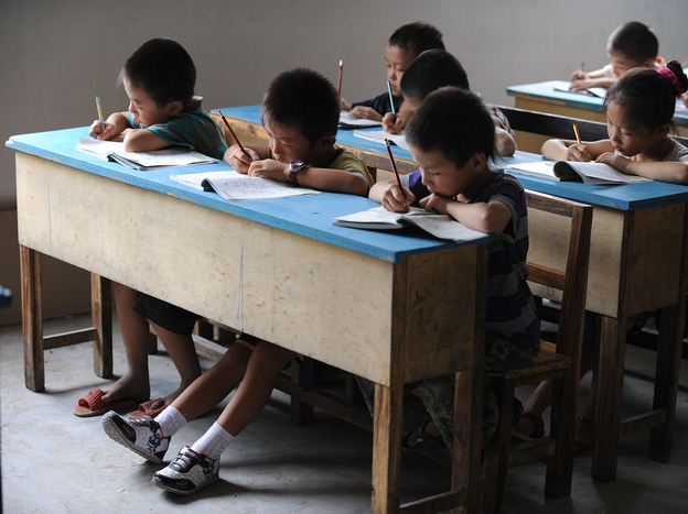Chinese schoolchildren during lessons at a classroom in Hefei, east China's Anhui province, in 2010. STR/AFP/Getty Images