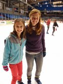 NHRI counselor Brooke Talbott (right) and junior counselor Katherine spending an evening at the ice rink.