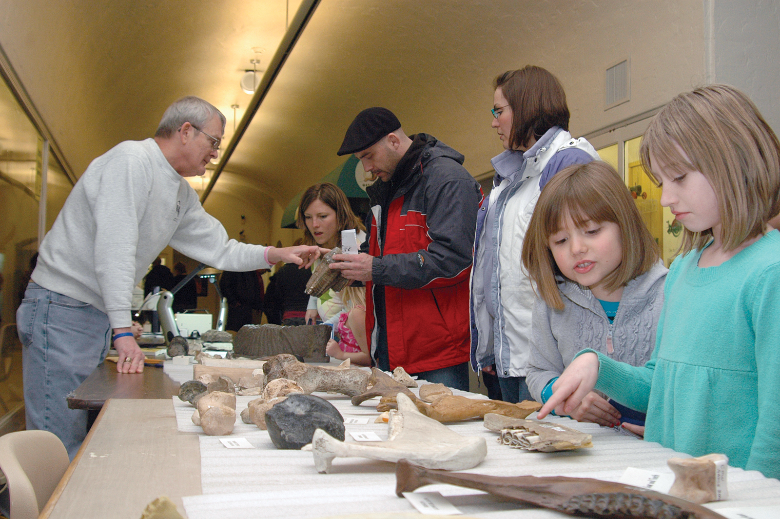 George Corner (at left), collections manager for the NU State Museum, talks with visitors during the 2011 Dinosaurs and Disasters.