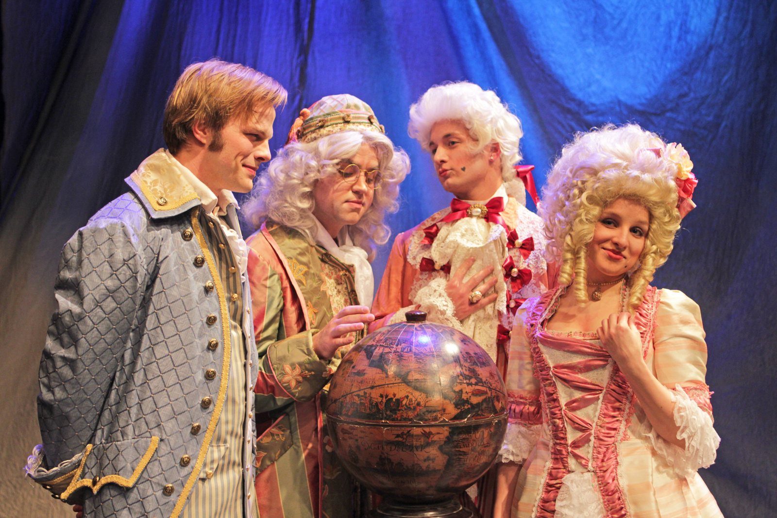 "A ""Candide"" scene featuring Dr. Pangloss and his students Candide, Maximillian and Cunegonde."
