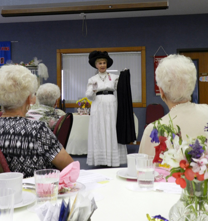 """Susan McLain leads a """"Yesterday's Lady"""" presentation."""