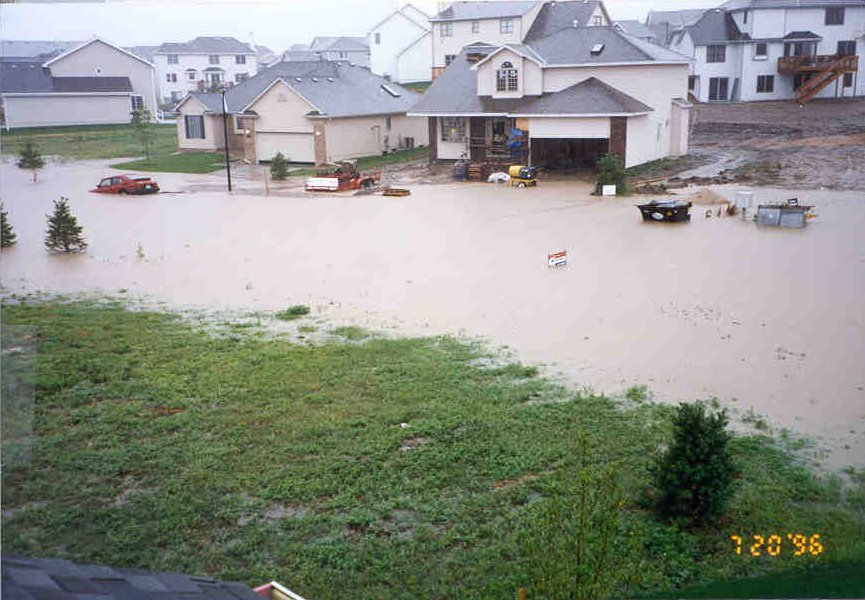 Street flooding from stormwater runoff in a new housing development.