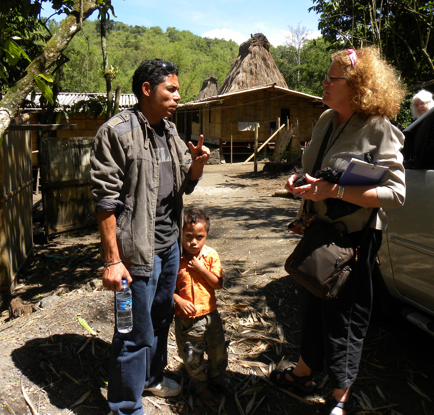 Barbara Rieke Turner and a translator discuss the art of a village in a remote area of Flores, Indonesia. (Photo courtesy Kim Hammer)