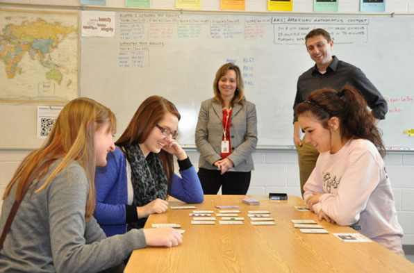 Waverly High School seniors (from left) Bailey Rosecrans, Mariah Zautke and Kyleigh Dixon play a math game. (Staff Photo by Erik Dodge)