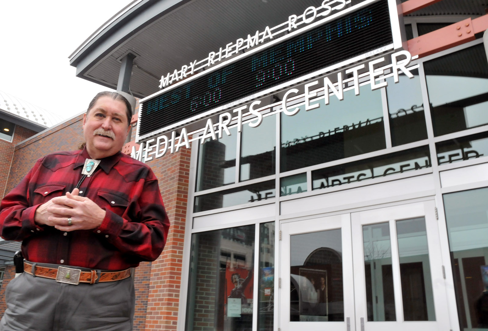 Danny Lee Ladely, who is in his 40th year at UNL, stands outside the Mary Riepma Ross Media Arts Center.