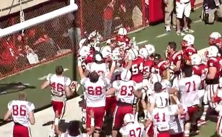 Husker football players lift Jack Hoffman, 7, after his 69-yard touchdown run in Saturday's Red-White Spring Game. (Huskers.com)