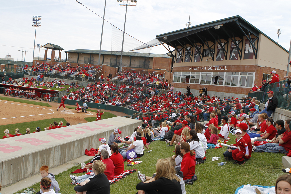 "Fans watch the game prior to the 2012 ""World's Largest Softball Tailgate"" at UNL's Bowlin Stadium."