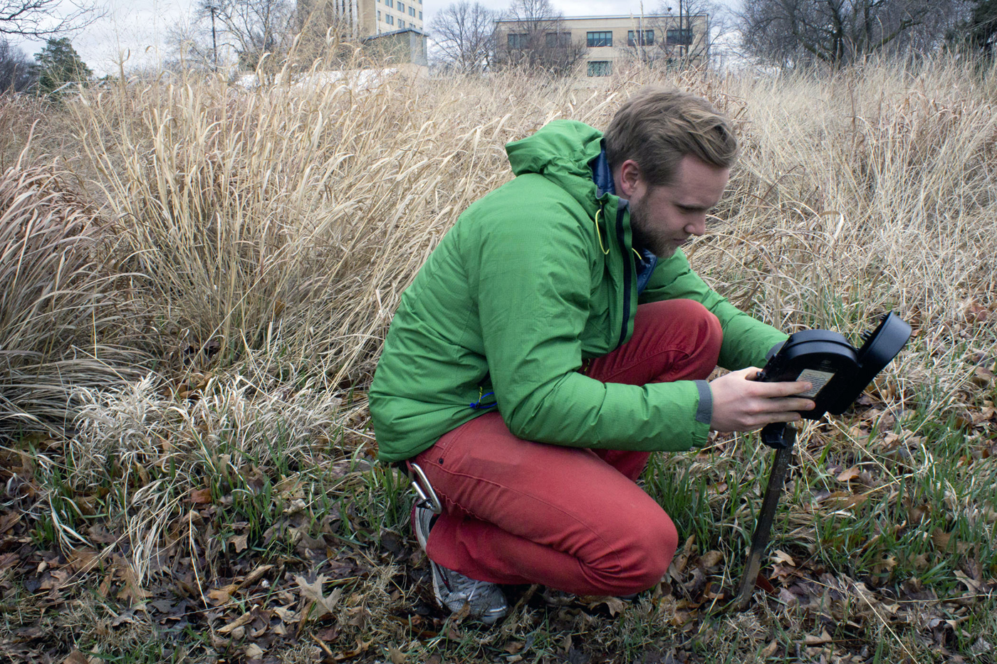 Peter Stegen, a senior fisheries and wildlife major, sets up a camera trap as part of his project for the Digital Imaging and Storytelling course.
