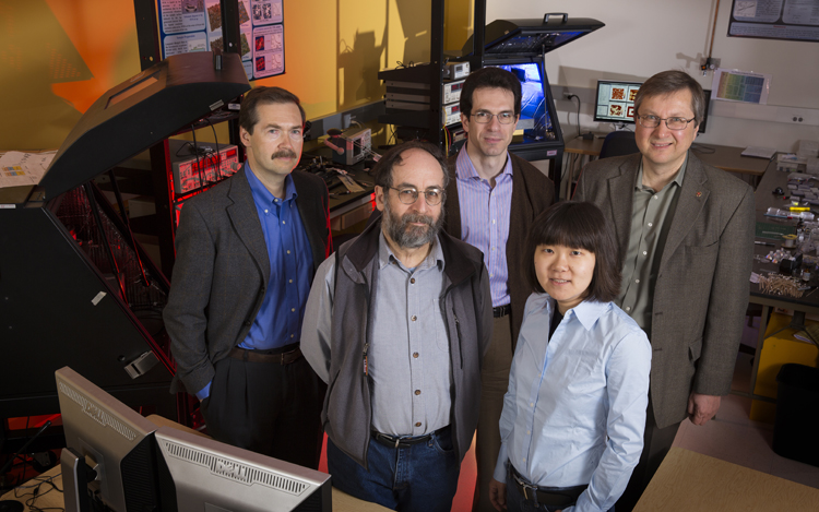 UNL physicists (from left) Alexei Gruverman; Peter Dowben, CNFD associate director; Kirill Belashchenko; Xia Hong, and Evgeny Tsymbal, CNFD director. Not pictured, Christian Binek. (Craig Chandler / University Communications)