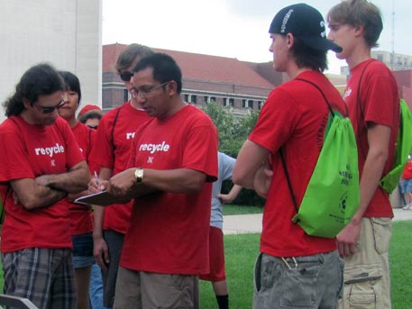 Prabs Shrestha (center), a recycling coordinator for UNL, guides volunteers during a Husker football gameday recycling effort. (Courtesy photo)