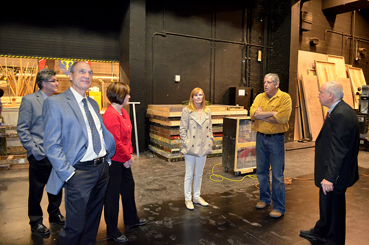 (left to right) Board members Hixson-Lied Endowed Dean Charles O'Connor, Mike Hill, Susan Varner Wilkins, Marg Helgenberger and Deon Bahr tour the Temple Building with Production Manager Brad Buffum (second from right) during their April 27 Hixson-Lied Bo