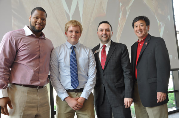 Ndamukong Suh (left) with Matthew Stier. With them are Eddy Rojas, director of UNL's Durham School of Architectural Engineering and Construction, and Engineering Dean Tim Wei.