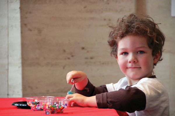 A child works with beads during a family day event at the Sheldon Museum of Art. (Nobuyuki Takahashi, Sheldon Museum of Art)