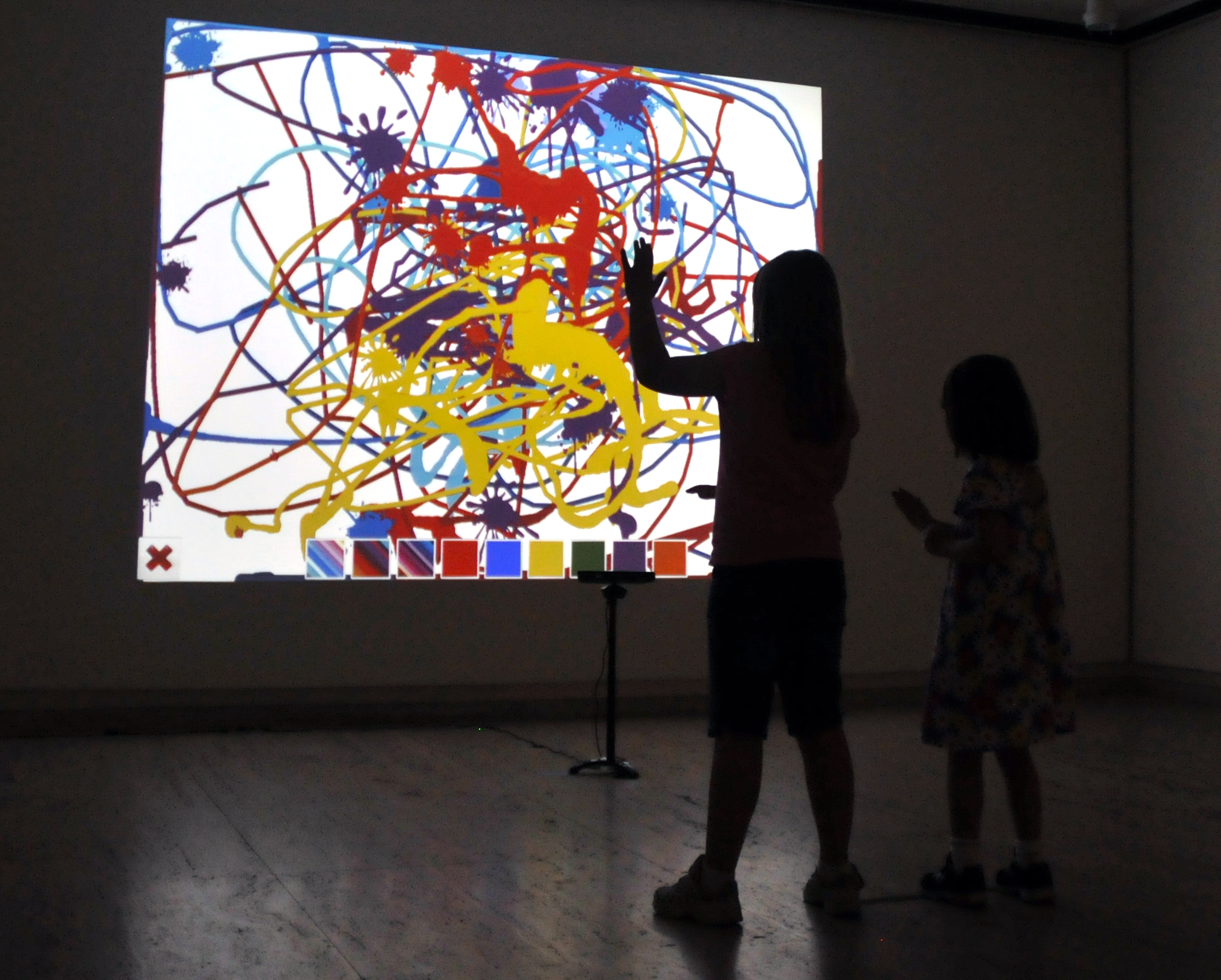 "Children create a digital painting with the ""Kinection Project"" in the Sheldon Museum of Art. (Troy Fedderson, University Communications)"