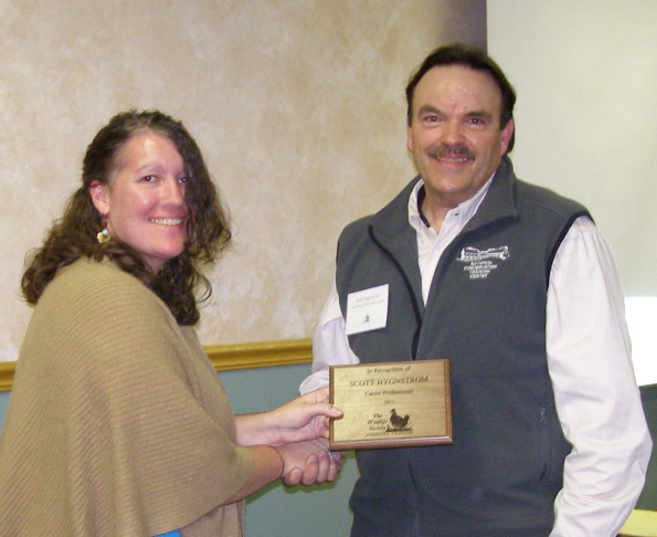 Teresa  Zimmerman Frink awards Scott Hygnstrom with a Career Award from the Nebraska Chapter of The Wildlife Society.