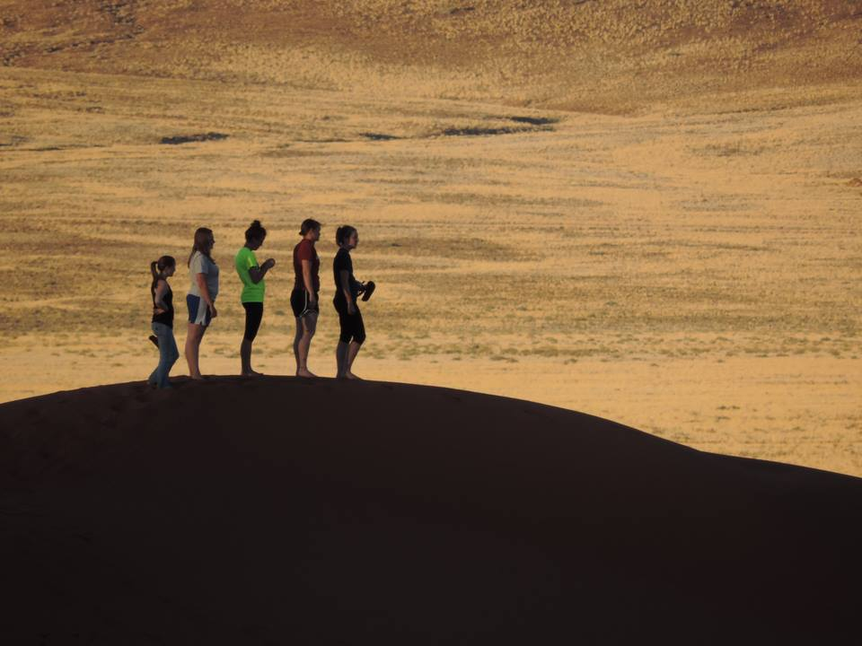 SNR students on a late-day hike in the dunes of Namibrand.