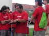 Prabs Shrestha (center), a UNL recycling coordinator, reviews procedures with Go Green for Big Red volunteers.