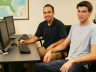Fabio Mattos (at left), assistant professor of agricultural economics, and Lee Sabata, a senior agricultural economics major from David City, work in a computer lab in Filley Hall that will soon be transformed into a state-of-the-art agricultural commodit