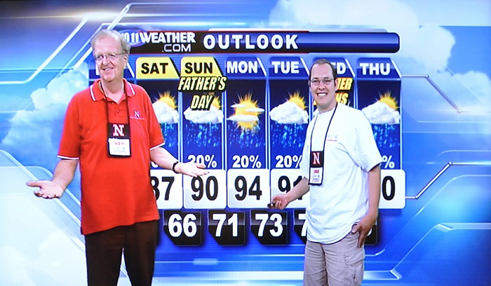 Ken Dewey (left) with a weather camp student in 2012.