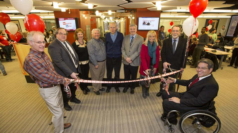 The Department of Chemistry celebrated the remodeling of Hamilton Hall's second floor chemistry laboratories and new resource center with a ribbon cutting. From left: Mark Griep, Dr. Jim Takacs, Peg Bergmeyer, Darrel Kinnan, Jim Carr, Jason Kautz, Alecia