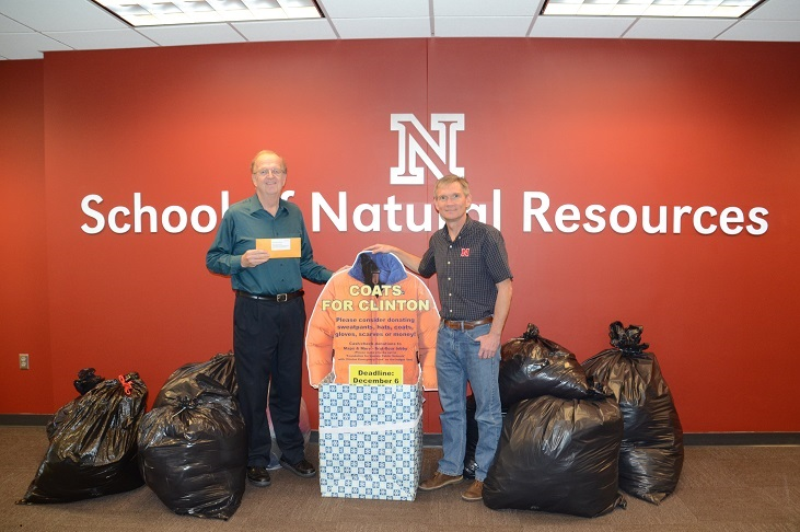 "Ken Dewey (left) and SNR director John Carroll with the ""Coats for Clinton"" donations."