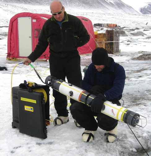 Bob Zook (left) and Marcus Kolb prepare the SCINI remotely operated vehicle for deployment in Antarctic waters.