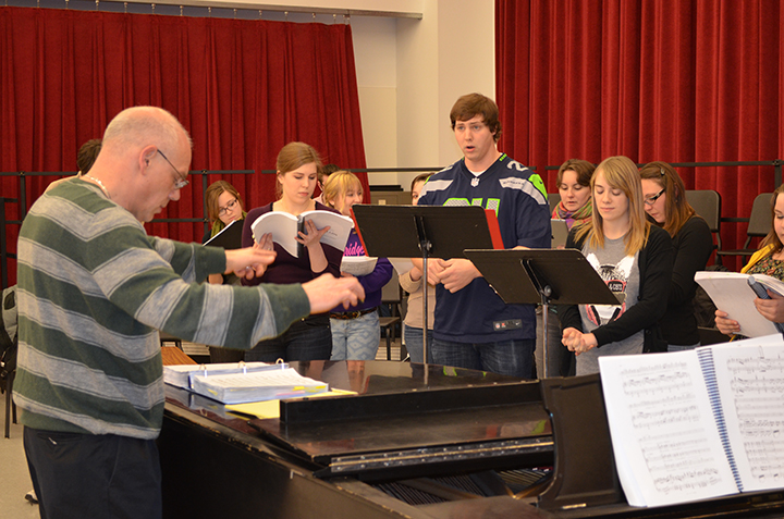 """Hixson-Lied Professor William Shomos (left) directs a music rehearsal with the cast of """"Cendrillon."""" Performances of the opera are Feb. 21 and 23 in Kimball Hall."""