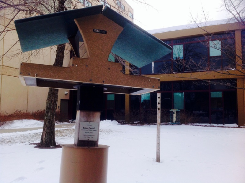 The two bird feeders donated by the Titteringtons in memory of Brian Smith. The feeders are located to the north of Hardin Hall on UNL's East Campus.