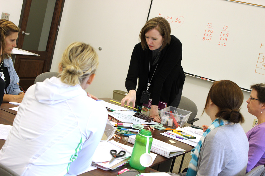 LPS district math coach Delise Andrews teaches Math 803P in 2013 in Lincoln.