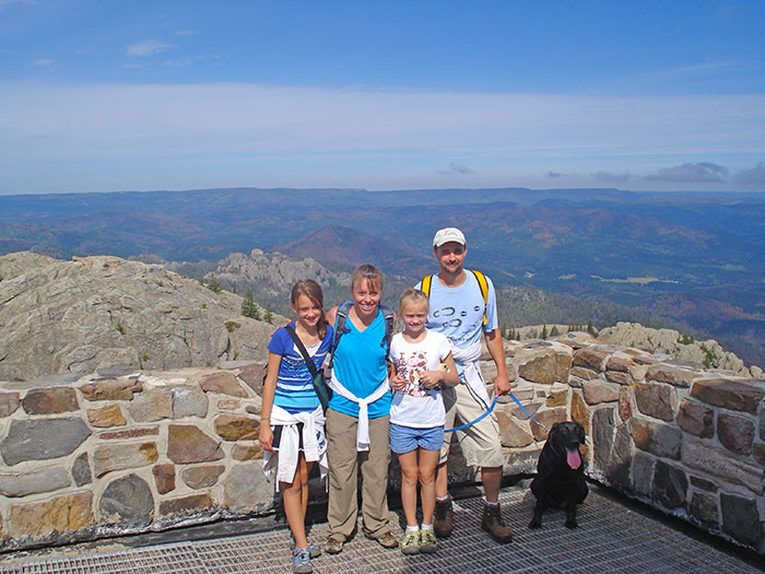 Ritch Nelson with his wife Kara, who he met at UNL, their two daughters Lena and Thori, and their black lab Cinder at the top of Harney Peak in South Dakota. (Courtesy photo)