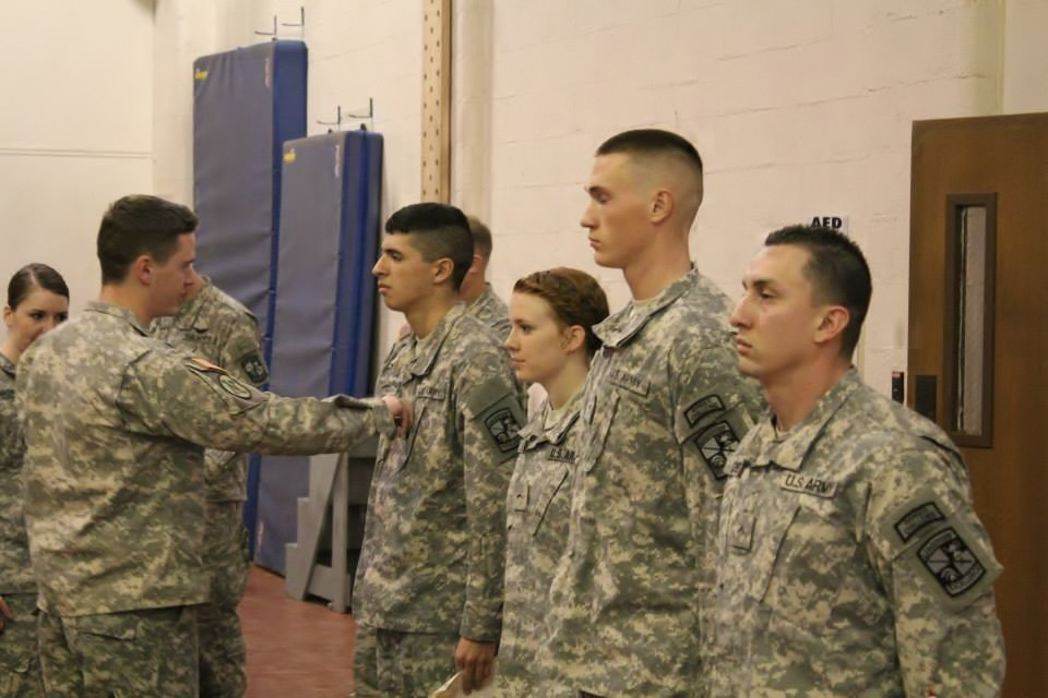 Courtney Everhart, middle, receives a promotion from Cadet Private to Cadet Private First Class. She received the high honor during her first semester in the Army ROTC. (Courtesy photo)