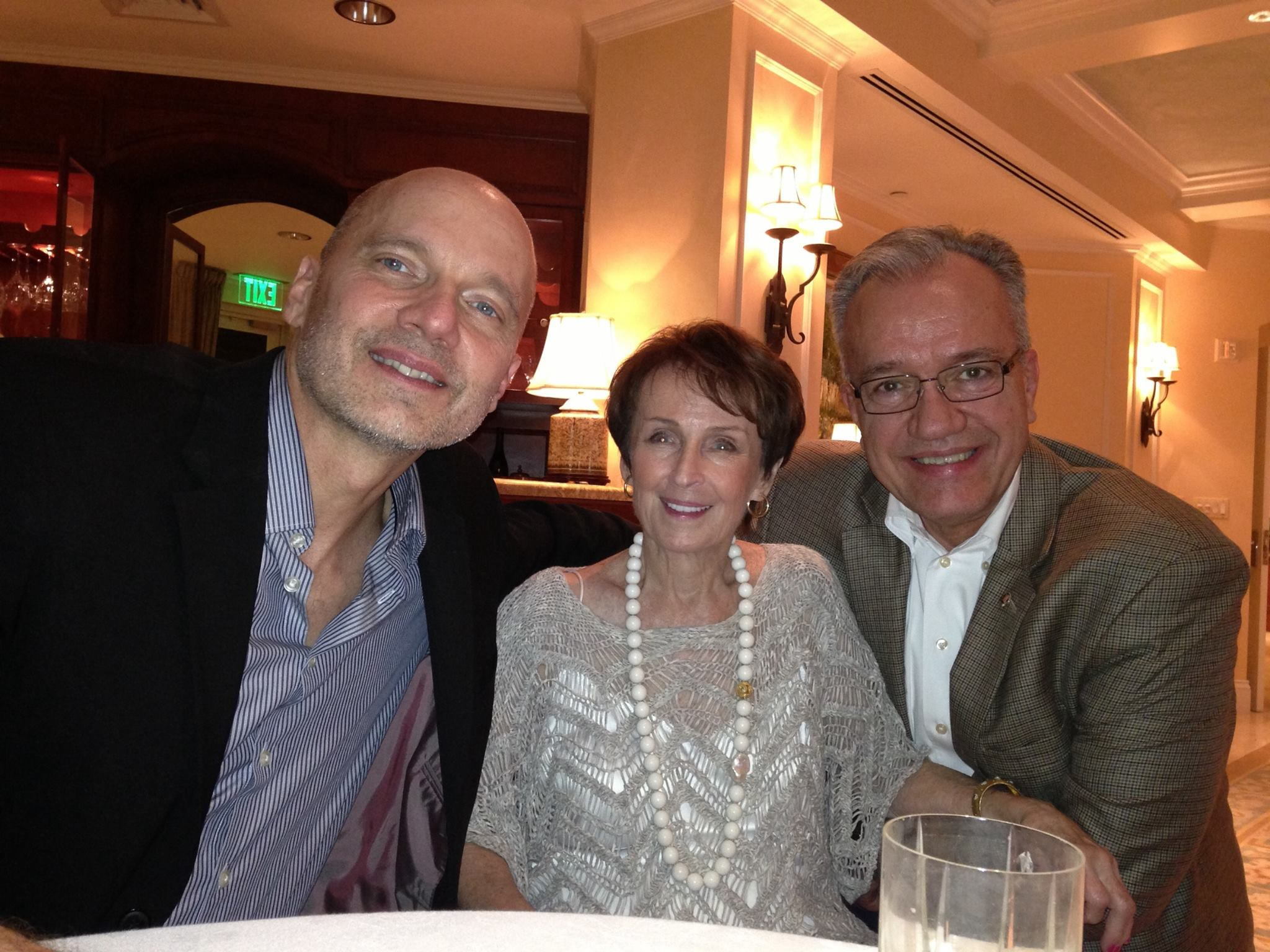 Paul Barnes (left) and John W. Richmond with Marguerite Scribante in Naples, Fla., in March.