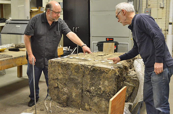 Professor of plant and ecosystem ecology Dave Wedin (left) and David Murphy, senior research architect at the Nebraska State Historical Society, with the sod wall. (Mekita Rivas   Natural Resources)