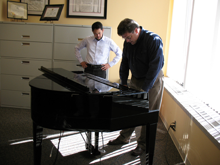 Assistant professor Damon Thomas Lee (left) and professor Tyler White listen to the harp sound on the Yamaha AvantGrand Piano in Westbrook Music Building.