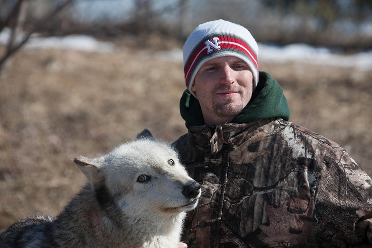 Brian Gaston with Kailani, a female gray wolf who was born at Wolf Park and is 10 years old. (Courtesy photo)