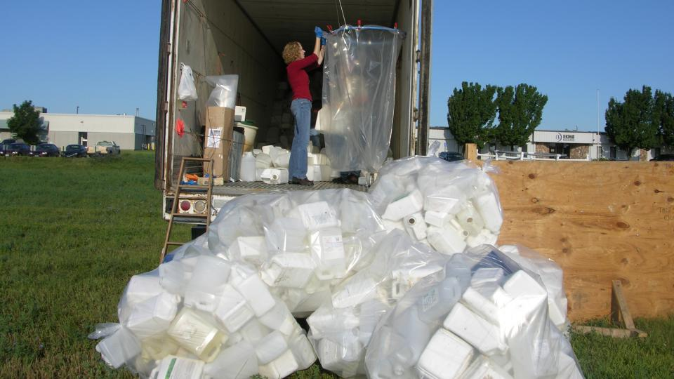 Leah Sandall, a lecturer in agronomy and horticulture, works at a UNL Extension pesticide container recycling site. The program, which has recycled more than 1,000 tons of the containers, is in its 23rd year. (Photo courtesy UNL Extension)