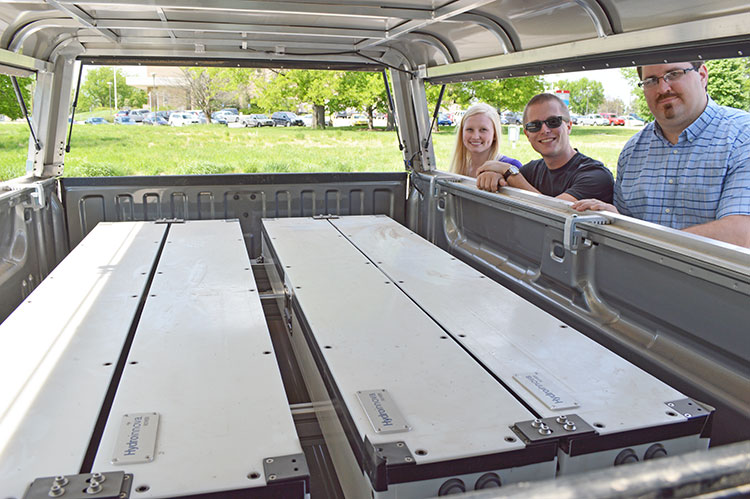 Trenton Franz (far right) and his two student workers, William Avery and Catie Finkenbiner, with the new cosmic-ray sensor. (Mekita Rivas | Natural Resources)