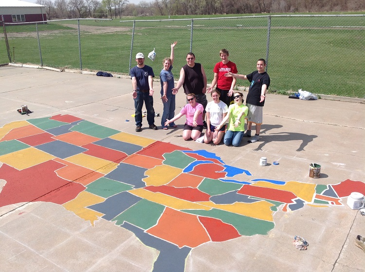 GSO students pose by the nearly complete U.S. map painted on a Scribner-Snyder Community Schools playground. (Courtesy photo)