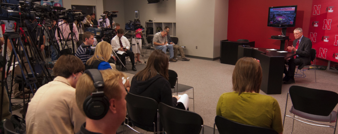 Tom Osborne, athletic director, discusses the proposed expansion projects with members of the media on Oct. 8.