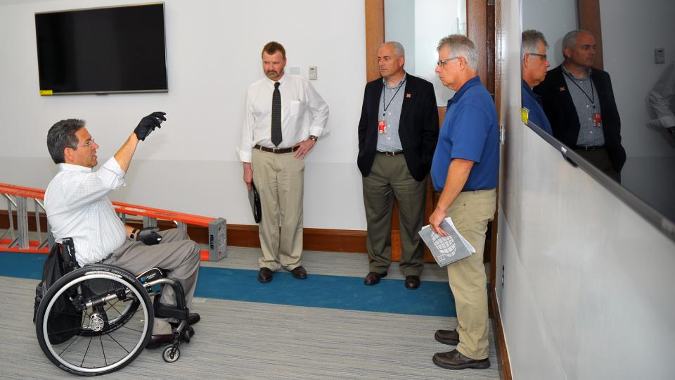 Lance Pérez (from left) talks with UNL's Chad Lea, Mark Miller and Dale Bowder in the virtual life sciencs lab on the second floor of Brace Laboratory on Aug. 18. The building reopens Aug. 25 after an $8 million renovation. (Image credit: Troy Fedderson)
