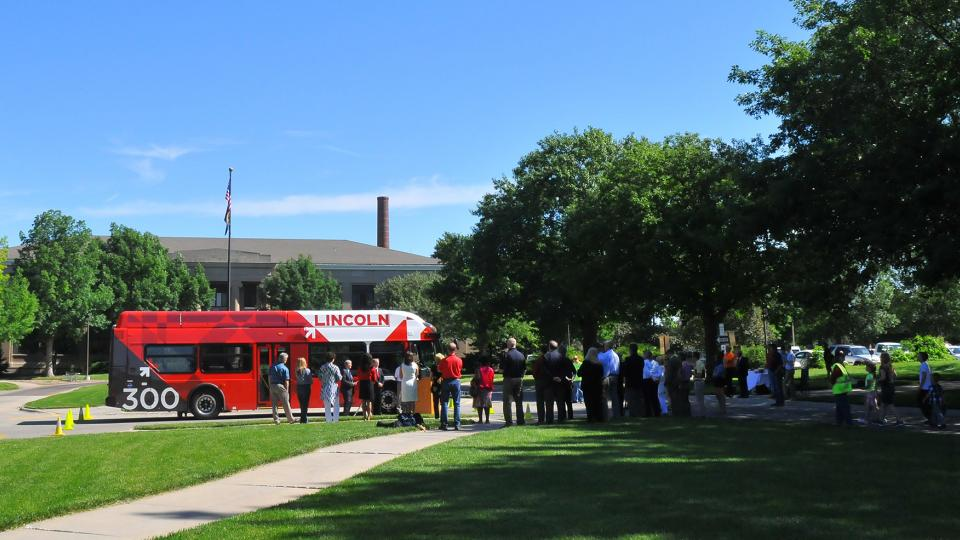 A crowd listens as civic leaders announced the addition of five new StarTran buses that run on compressed natural gas.