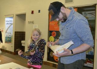 Morrill Hall visitors examining fossils
