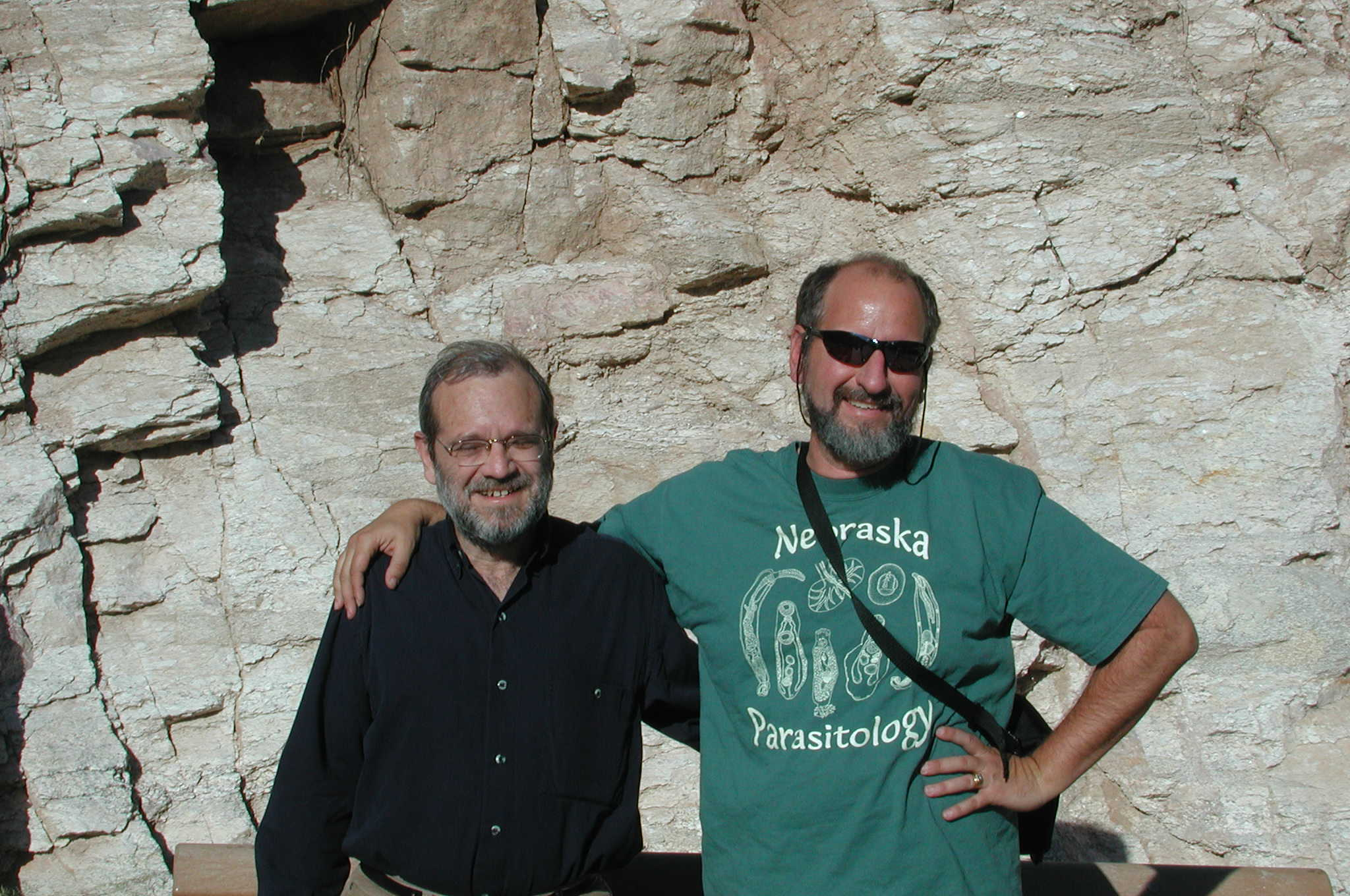Karl Reinhard (right) with co-author and research partner Adauto Araújo exploring rock shelters in the Lower Pecos Canyonlands.