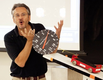 Dan Claes, chair of the department of Physics and Astronomy, demonstrates in front of a class.