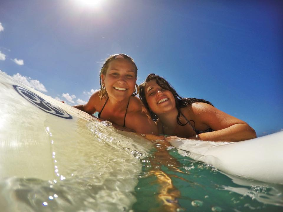 Lindsey McVay (left) with a friend while surfing in Hawaii. (Courtesy photo)