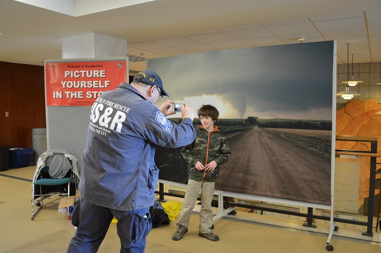 A Weatherfest attendee gets his picture taken with a tornado image at the 2014 event. (Mekita Rivas | Natural Resources)