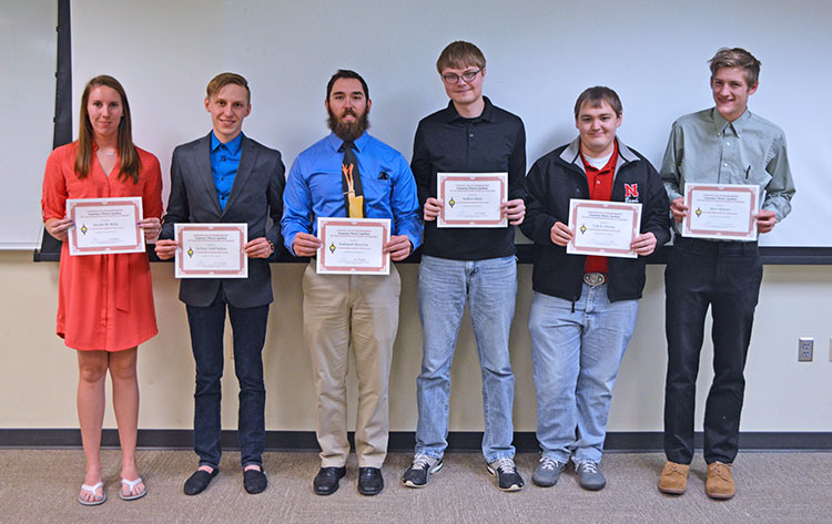 Newly inducted members of UNL's Gamma Theta Upsilon chapter with their membership certificates at the April 10 ceremony. (Mekita Rivas | Natural Resources)