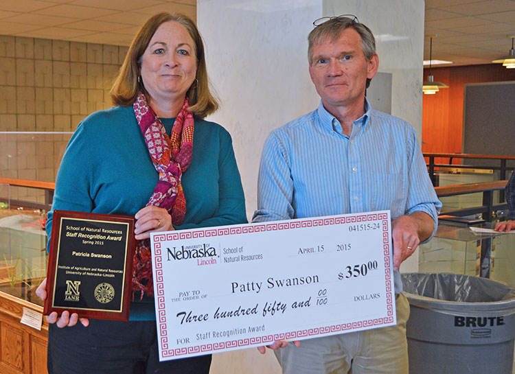 SNR director John Carroll presents Patty Swanson with the spring 2015 SNR Staff Recognition Award on April 15. (Mekita Rivas | Natural Resources)